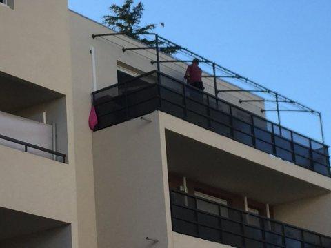 Réalisation d'une PERGOLAS sur mesure et pose sur un balcon du dernier étage